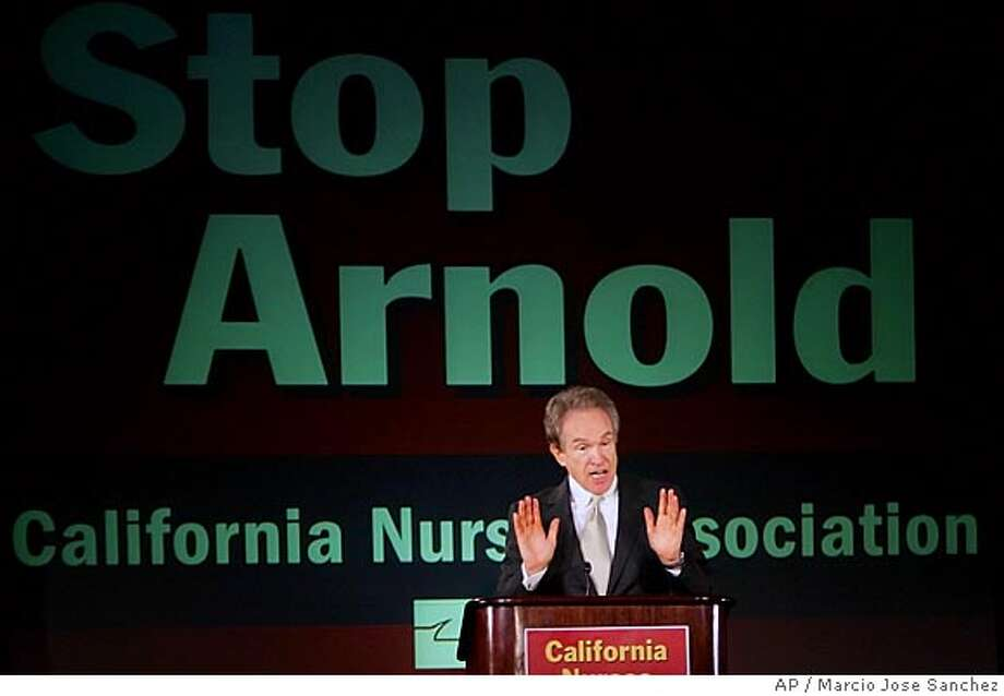 Actor Warren Beatty addresses members of the California Nurses Association on Thursday, Sept. 22 in Oakland, Calif. Beatty, a Democrat who has been mentioned as a possible challenger to Gov. Arnold Schwarzenegger next year, has in the past few months emerged as one of the governor's most visible and vociferous critics. (AP Photo/Marcio Jose Sanchez) Photo: MARCIO JOSE SANCHEZ