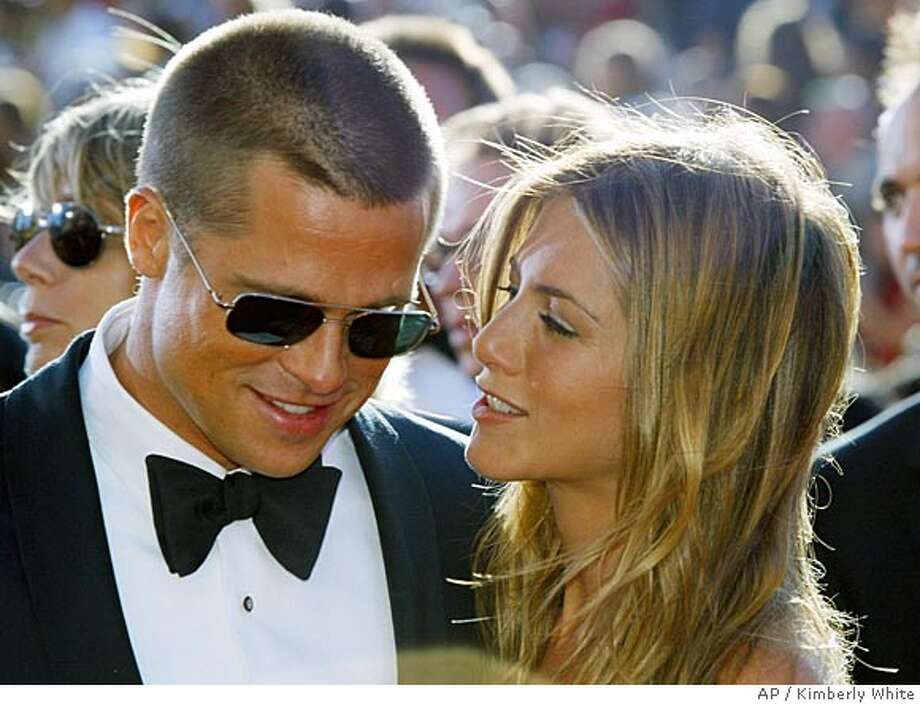 "Hollywood power couple Brad Pitt and Jennifer Aniston (news) have separated after four and one-half years of marriage but remain ""committed and caring friends,"" the couple said on January 7, 2005. ""We would like to announce that after seven years together we have decided to formally separate,"" Pitt and Aniston, who first met on a dinner date in 1998, said in a joint statement. Pitt and Aniston are pictured arriving at the 56th annual Primetime Emmy Awards at the Shrine Auditorium in Los Angeles, in this September 19, 2004 file photo. REUTERS/Kimberly White/Files Ran on: 01-08-2005  Brad Pitt and Jennifer Aniston had been together since being set up on a date in 1998.  ALSO RAN: 06/23/2005 Photo: KIMBERLY WHITE"