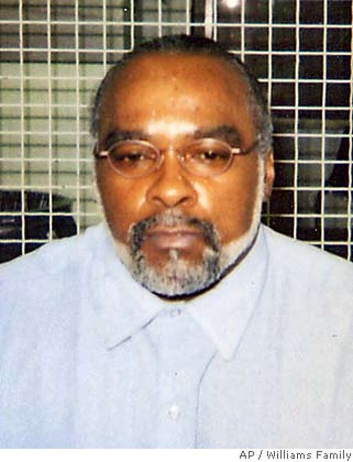 "** FILE ** In this undated photo provided by the family of Stanley Williams, Stanley ""Tookie"" Williams poses for a photo in the visiting area of San Quentin State Prison in California. Williams has received the President's Call to Service Award, complete with a letter from the White House signed by President Bush praising the co-founder of the notorious Crips gang for demonstrating ""the outstanding character of America."" Williams, 53, who started the Crips in Los Angeles in 1971 with high school buddy, Raymond Washington, was convicted in 1981 for killing four people. He's been on death row at San Quentin State Prison for two dozen years. (AP Photo/Courtesty of Williams Family, File) Photo: Ap"