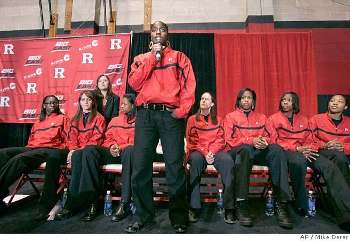 Matee Ajavon, center, a junior on the Rutgers University women's basketball team speaks at a news conference on campus in Piscataway, N.J., Tuesday, April 10, 2007, to react to racially derogatory remarks directed at their team made on air by radio personality Don Imus. The team said they would meet privately with Imus. (AP Photo/Mike Derer)