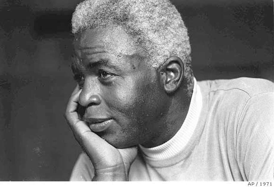 ** FILE ** Jackie Robinson looks pensive at his Stamford, Conn., home, in this June 30, 1971 file photo, as he discusses the death of his son Jack, Jr.(AP Photo) PHOTO MADE JUNE 30, 1971. Photo: JW