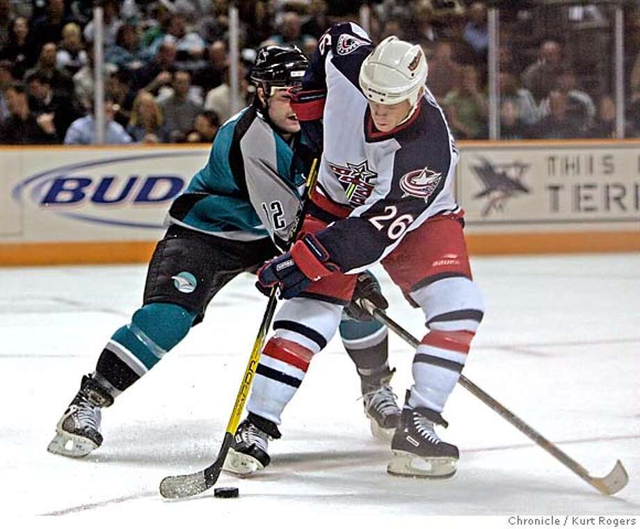 First period action with Patrick Marleau and Todd Malhotra tangle.  The San Jose Sharks vs the Columbus Blue Jackets SHARKS_0434_kr.JPG 10/12/05 in San Jose,CA.  KURT ROGERS/THE CHRONICLE MANDATORY CREDIT FOR PHOTOG AND SF CHRONICLE/ -MAGS OUT Photo: KURT ROGERS