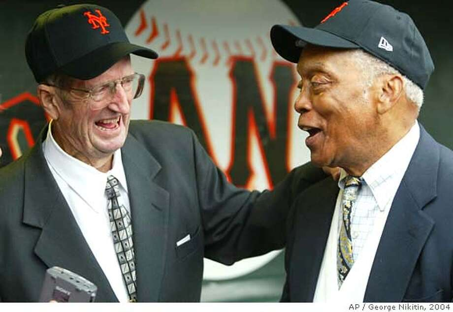 Don Mueller, left, and Monte Irvin, both members of the 1954 champion New York Giants, have a laugh in the San Francisco Giants dugout in SBC Park, Saturday, July 31, 2004, in San Francisco. Members of the 1954 team were honored in a pre-game ceremony. (AP Photo/George Nikitin) Photo: GEORGE NIKITIN