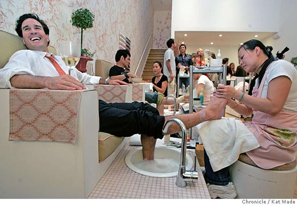 """MODERNLIFE_079_KW.jpg On 9/27/04 in San Francisco Brad Zampa from Marin chats with Matt Rogers (NOT PICTURED) while he is given his first ever pedicure by Helen Ly during """"metrosexual"""" night at Teashi Salon on Polk Street, 25 men were invited for beer, pizza, manicures, pedicures and facials. Kat Wade/The Chronicle"""