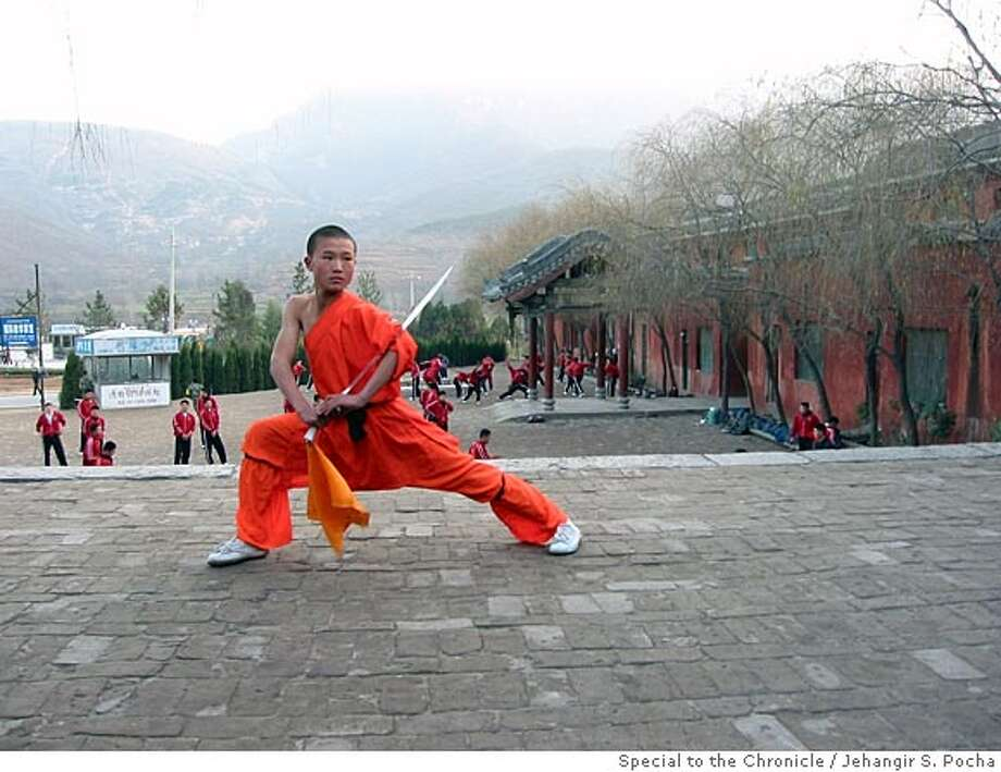 CHINA_SHAOLIN.JPG Cai Qing Bin, 13, training in the shadow of the Shaoshi mountains in the courtyard of the Shaolin school. Jehangir S. Pocha/ Special to Chronicle Photo: Jehangir S. Pocha