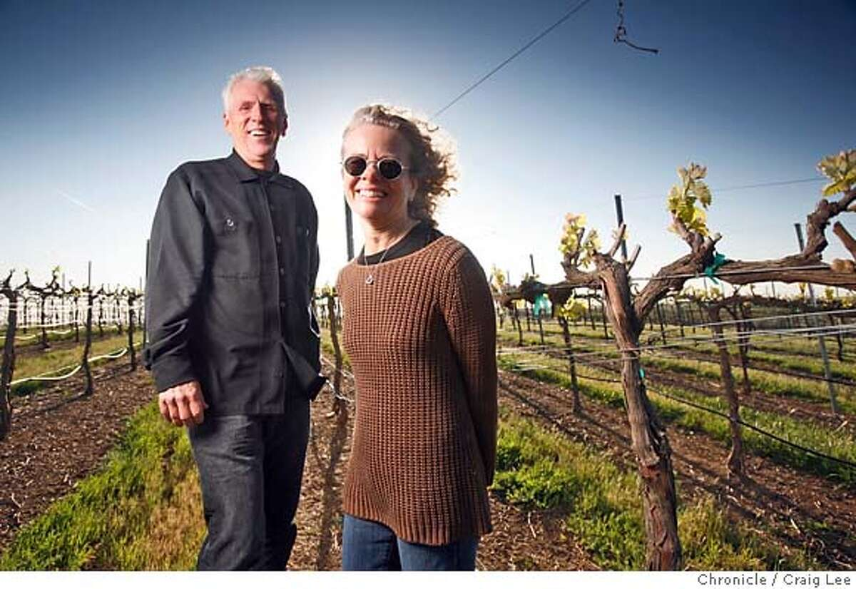 YOLO13_309_cl.JPG Photo for a story on wineries in Yolo county. This is John and Lane Guigiure, owners of Crew Wine Company. They used to own R.H. Philips wine. Photo of them in the Dunnigan Hills vineyard near Zamora. Event on 3/28/07 in Zamora. photo by Craig Lee / The Chronicle MANDATORY CREDIT FOR PHOTOG AND SF CHRONICLE/NO SALES-MAGS OUT