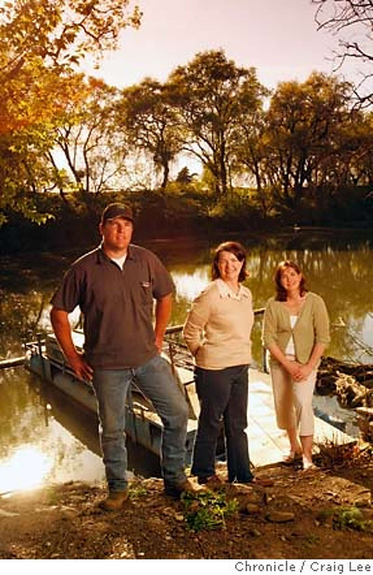YOLO13_787_cl.JPG Photo for a story on wineries in Yolo county.This is Bogle Vineyards in Clarksburg. Photo of left-right: Warren Bogle (named after after his grandfather and founder of Bogle Vineyards), Patty Bogle (Warren's mother), and Jody Bogle Van dePol (Patty's daughter and Warren's sister). Photo was taken out across from their vineyard at Elk Slough, which is where they get some of their water for the vineyard. Elk Slough connects to the Sacramento River. Event on 3/29/07 in Clarksburg. photo by Craig Lee / The Chronicle MANDATORY CREDIT FOR PHOTOG AND SF CHRONICLE/NO SALES-MAGS OUT