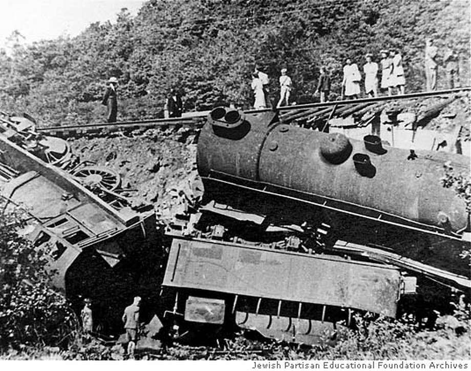 Sabotage of Nazi Supply Train  Location Unkown Partisans often mined the tracks of Nazi supply trains. Rich Coen, in his book The Avengers, reports that in 1943, the partisans destroyed one thousand trains per month. Here, Belgian civilians view a German train derailed by the Belgian resistance.Partisans often mined the tracks of Nazi supply trains. Credit The Jewish Partisan Educational Foundation Photo Archive. Source: JPEF Website courtesy of Center for Historical Research and Documentation on War and  Contemporary Society Brussels, Belgium. Photo: Ho