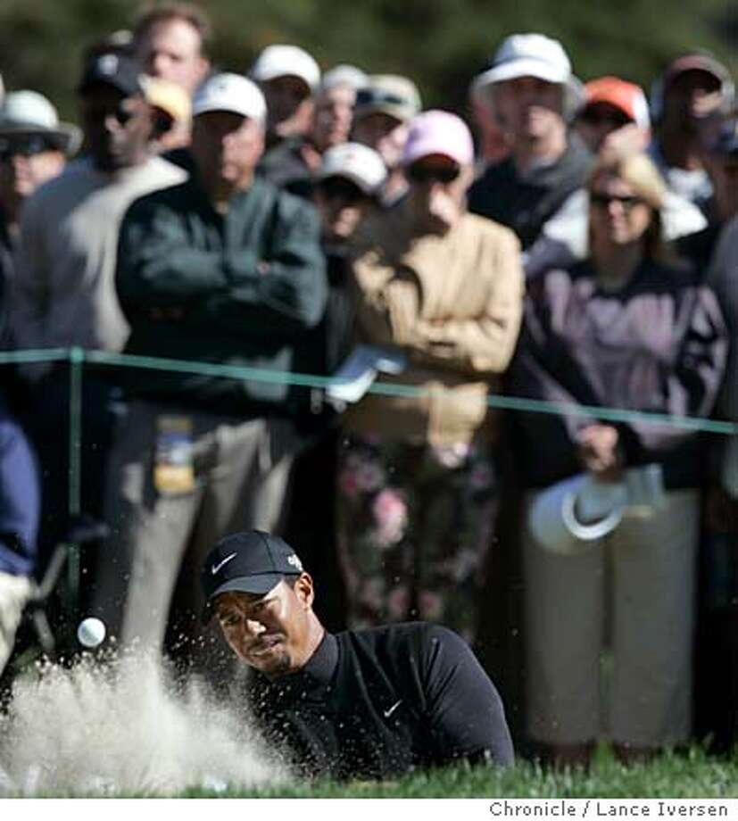 AMEXGOLF_1324.jpg_  Tiger Woods blast out of the trap on the 7th hole. The 3rd round of the American Express Championship got underway at San Francisco's Harding Park Thursday under sunny skies. By Lance Iversen/San Francisco Chronicle Photo: Lance Iversen