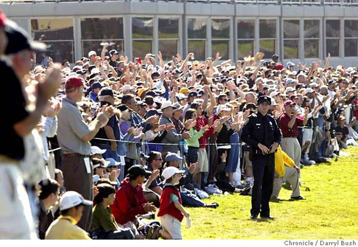 AMEXgolf_0028_db.jpg The crowd cheers around the 18th hole as John Daly and Tiger Woods as they head out for a playoff to the 18th at the American Express Championship at Harding Park Golf Course. Event on 10/9/05 in San Francisco. Darryl Bush / The Chronicle MANDATORY CREDIT FOR PHOTOG AND SF CHRONICLE/ -MAGS OUT