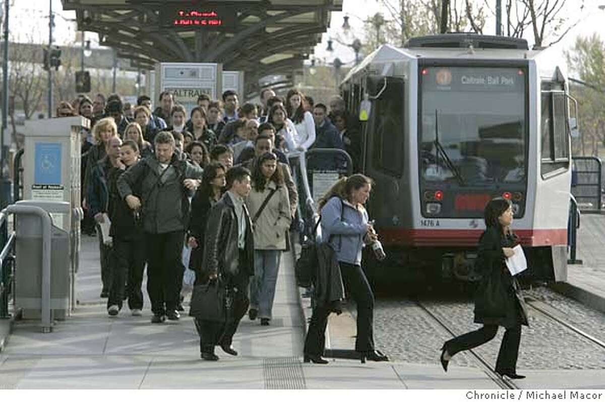 muni_197_mac.jpg Evening commuters scramble from a J Line Train to cross King St. for the CalTrain station just across the street. With MUNI's new T train line now in place commuters are facing challenges at the intersection of 4th and King Sts. commuters scramble during commute time to catch connections with CalTrain just across the street. The J and T trains must wait for each other to clear the intersection before proceeding across. Photographed in, San Francisco, Ca, on 4/11/07. Photo by: Michael Macor/ The Chronicle Mandatory credit for Photographer and San Francisco Chronicle No sales/ Magazines Out