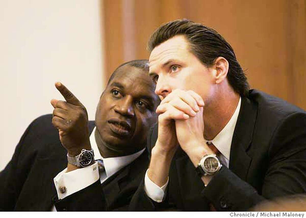 Municipal Transportation Agency Director Nathaniel Ford (left) points to a power point projection display on the Muni lines to Mayor Mayor Gavin Newsom (right). Mayor Gavin Newsom and Municipal Transportation Agency Director Nathaniel Ford held a roundtable discussion today April 11, 2007 at City Hall that focused on various San Francisco transportation issues Photo by Michael Maloney / San Francisco Chronicle ***Gavin Newsom, Nathaniel Ford MANDATORY CREDIT FOR PHOTOG AND SF CHRONICLE/NO SALES-MAGS OUT