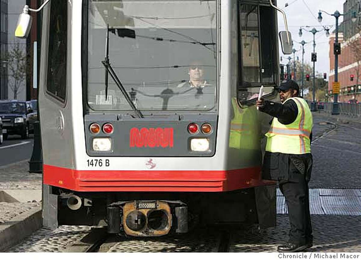 muni_175_mac.jpg MUNI personel and train operators work together to make sure of the new route through the 4th and King Sts. intersection. With MUNI's new T train line now in place commuters are facing challenges at the intersection of 4th and King Sts. commuters scramble during commute time to catch connections with CalTrain just across the street. The J and T trains must wait for each other to clear the intersection before proceeding across. Photographed in, San Francisco, Ca, on 4/11/07. Photo by: Michael Macor/ The Chronicle Mandatory credit for Photographer and San Francisco Chronicle No sales/ Magazines Out