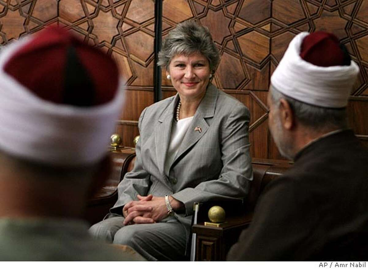 Karen Hughes, U.S. undersecretary of state for public diplomacy and public affairs, meets with Al Azhar Sheik Mohammed Sayyed Tantawi, right, the highest Islamic Sunni authority, in Cairo Egypt Sunday, Sept. 25, 2005. Hughes takes her first trip in her new job to counter negative attitudes about U.S. policies in the Middle East. (AP Photo/Amr Nabil) Ran on: 09-26-2005 Karen Hughes