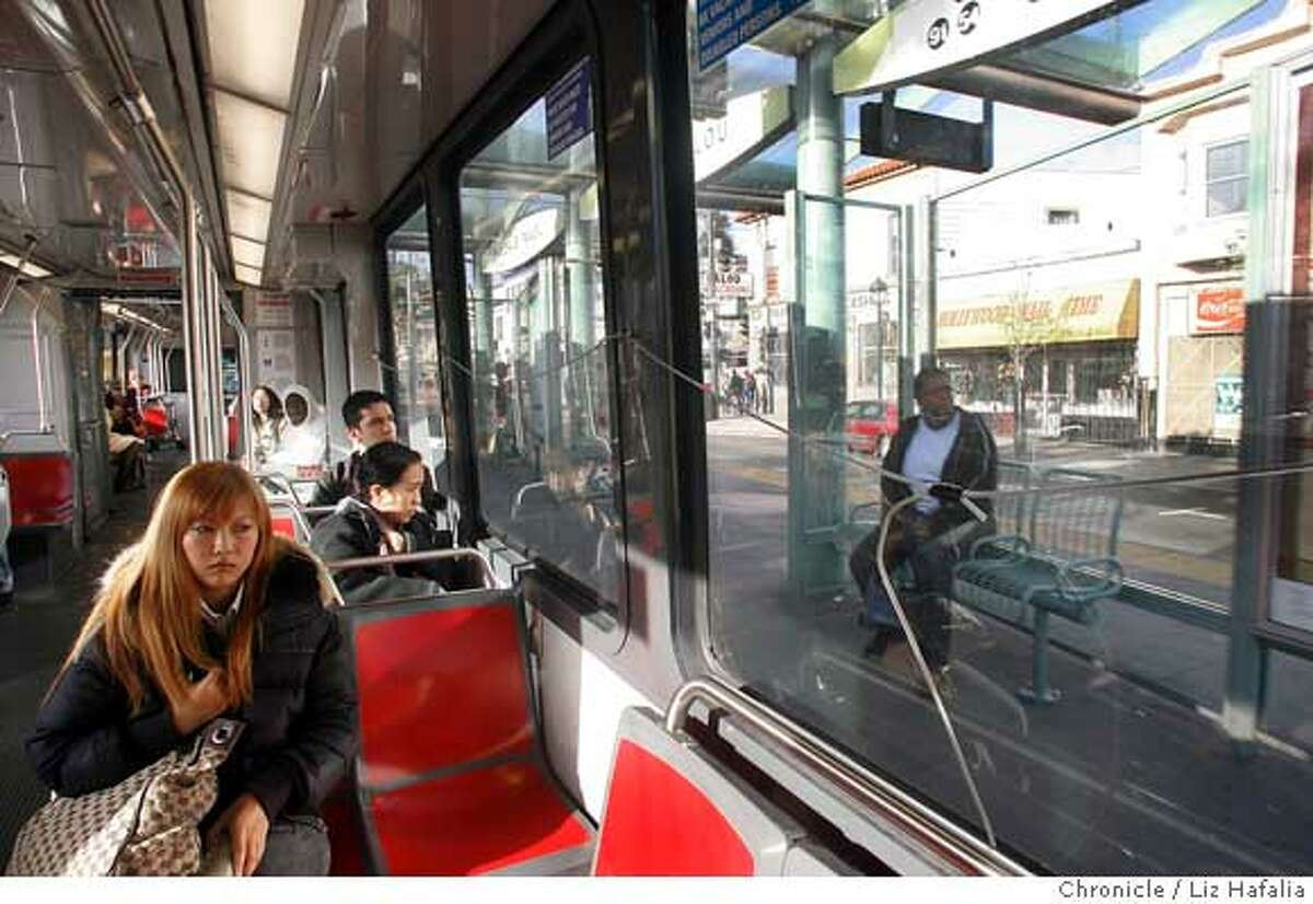 Kyoko Katayama (left) gets on at the Palou station and likes watching for the time of the next train coming in. San Francisco's new T-Third streetcar line starts weekday service. Liz Hafalia/The Chronicle/San Francisco/4/10/07 ** Kyoko Katayama cq