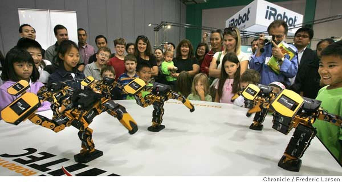 ROBOTS_0228_fl.jpg Crowds watched as the Robonova-1 robot did a ballet for the audience. Robonexus trade show in San Jose featuring robots: crawlers used for search and rescue in New Orleans, humanoid robots, robot soccer,