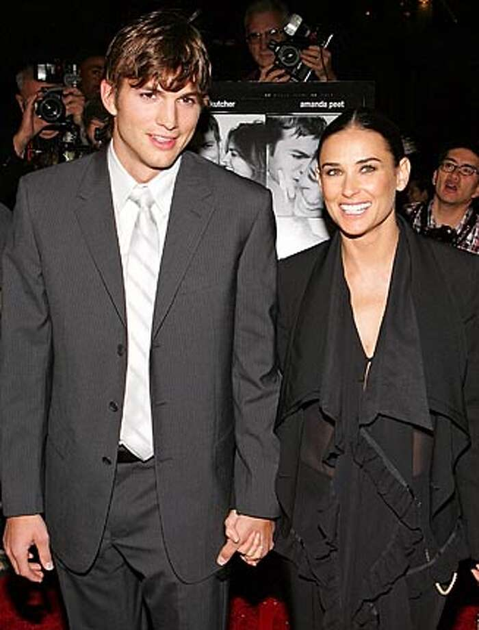 "Actors Ashton Kutcher and Demi Moore arrive for the premiere of ""A Lot Like Love"" in New York in this April 18, 2005 file photo. Moore and Kutcher were married on Saturday, capping their celebrated two-year-long older woman, younger man relationship, two celebrity magazines reported on September 25, 2005. Representatives for Kutcher, 27, and Moore, 42, could not be immediately reached for comment, but both Us Weekly and People magazine reported on the Web sites that the couple were married in Los Angeles area on Saturday. Picture taken April 18, 2005. REUTERS/Marion Curtis/startraksphoto/Handout/Files Ran on: 09-27-2005  Ashton Kutcher and Demi Moore met in 2003. Photo: HO"