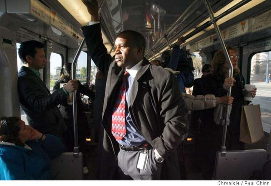 MTA director Nathaniel Ford rides an inbound T-Third Muni Metro train to monitor glitches in the system in San Francisco, Calif. on Thursday, April 12, 2007 following three days of delays caused by the launch of the T-Third line.  PAUL CHINN/The Chronicle  **Nathaniel Ford Photo: PAUL CHINN