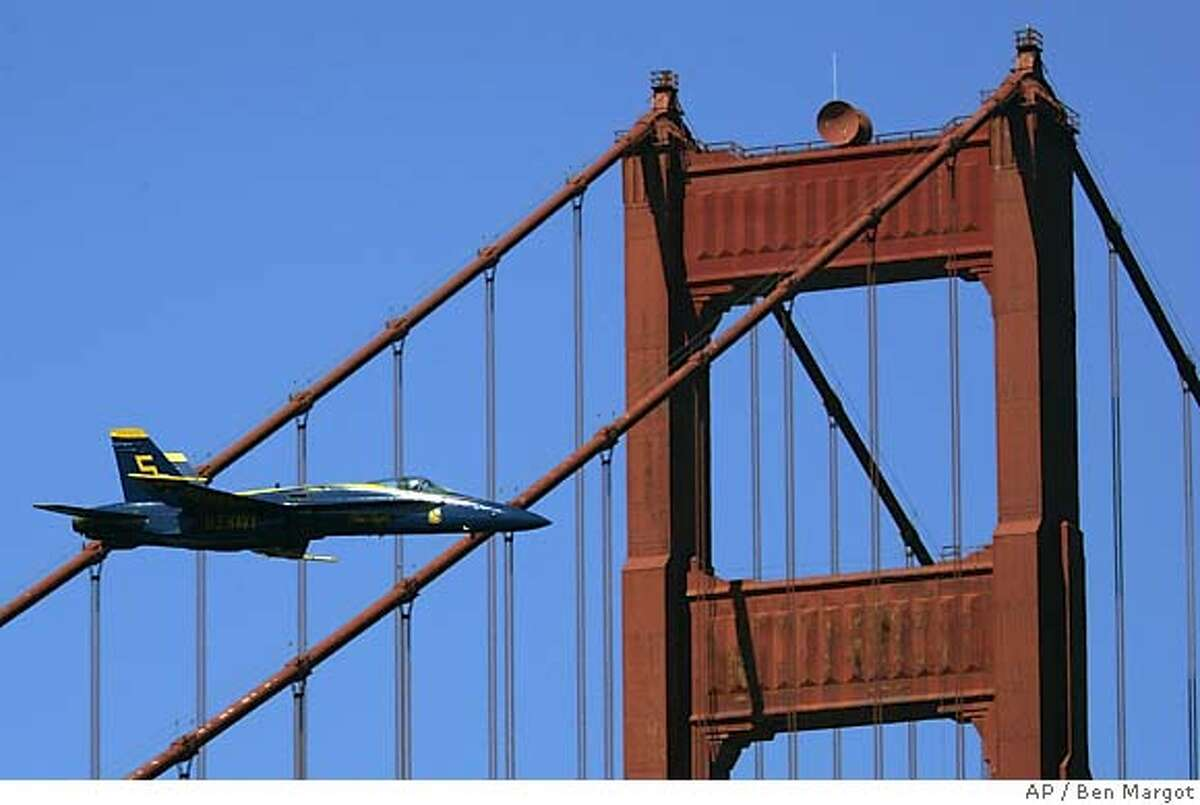 U.S. Navy Blue Angel flight demonstration left slot pilot, USN Lt. Cmdr. Craig Olson, flies his Blue Angel #5 F/A-18 Hornet jet aircraft over the south tower of the Golden Gate Bridge during a practice flight Thursday, Oct. 6, 2005, in San Francisco. The are preparing for two airshows this weekend over San Francisco Bay, part of Fleet Week San Francisco 2005 festivities; which celebrate the area's long Naval history. (AP Photo/Ben Margot)