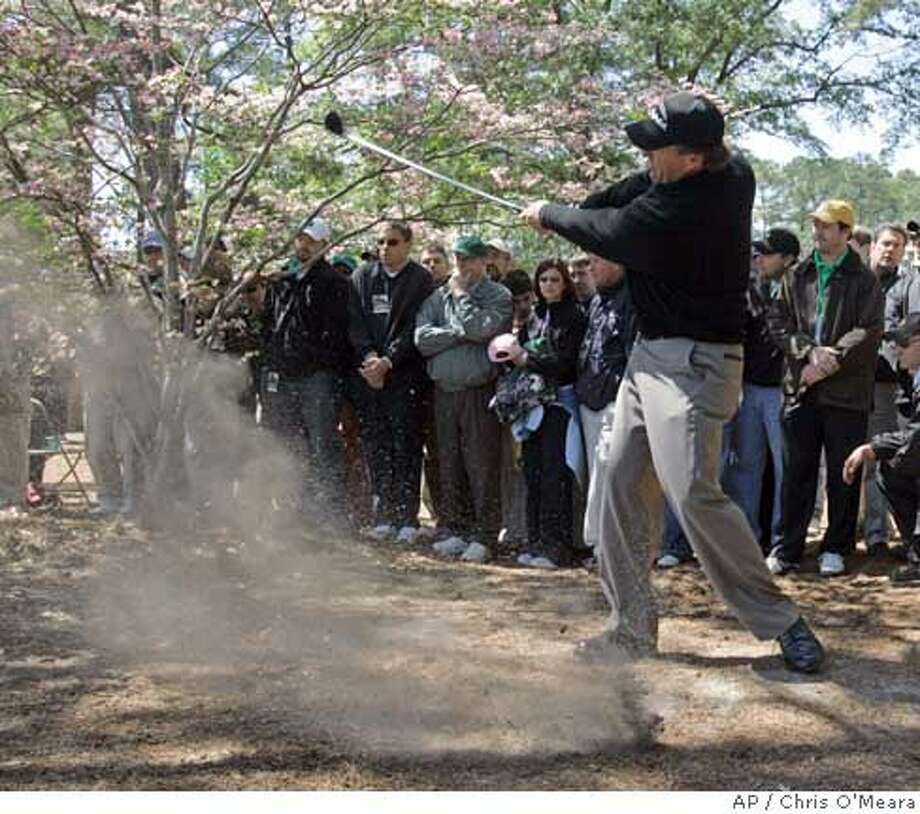 Phil Mickelson hits from rough on the second fairway during the third round of the 2007 Masters golf tournament at the Augusta National Golf Club in Augusta, Ga., Saturday, April 7, 2007. (AP Photo/Chris O'Meara) Photo: Chris O'Meara