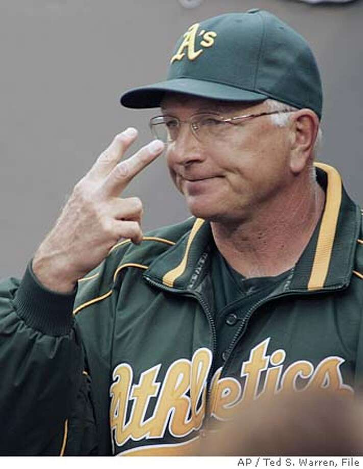 ** FILE ** Oakland Athletics manager Ken Macha signals during a game against the Seattle Mariners in this June 22, 2005 photo at Safeco Field in Seattle. Oakland Athletics general manager Billy Beane says manager Ken Macha is out of a job after failing to reach an agreement on a new contract. (AP Photo/Ted S. Warren) A JUNE 22., 2005 FILE PHOTO Photo: TED S. WARREN