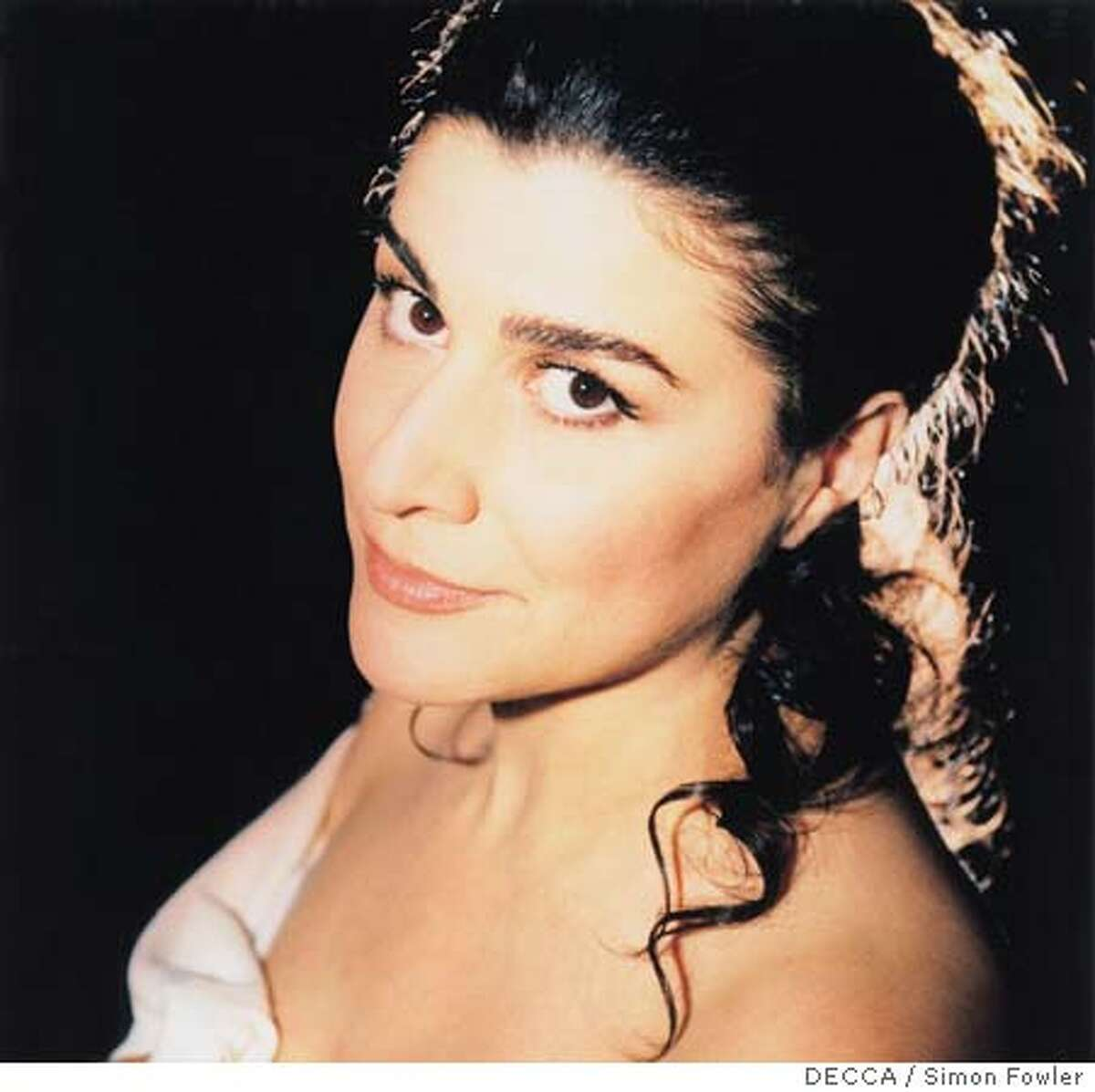 BARTOLI08 Since making her now-legendary 1991 West Coast recital debut at Cal Performances in Hertz Hall, Cecilia Bartoli has gone on to become one of the brightest stars in the opera firmament. The Grammy Award-winning mezzo-soprano returns to Cal Performances on October 6, 2005. Photo by: DECCA/Simon Fowler