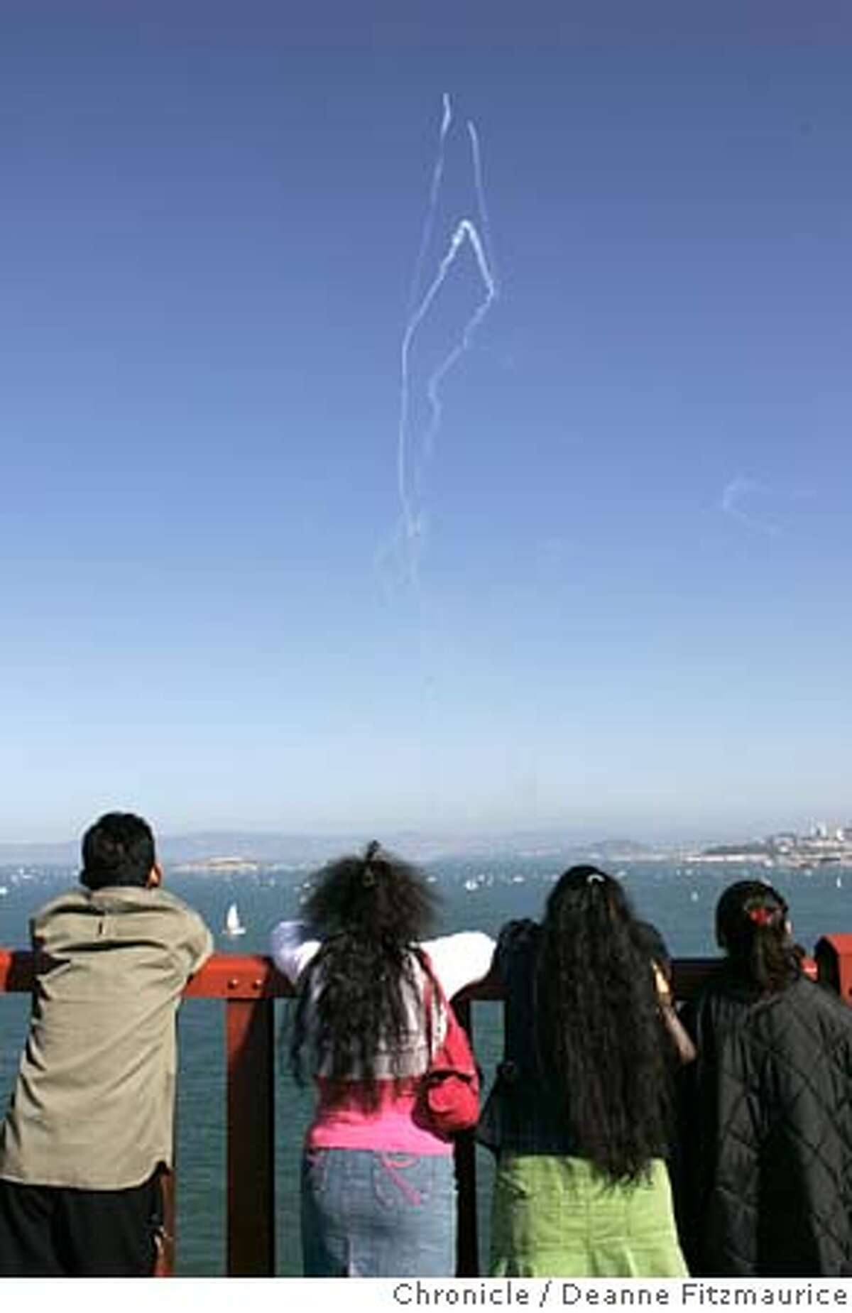 fleetweek_109_df.JPG People line the Golden Gate Bridge to watch the show. The Blue Angles fly over San Francisco Bay. Photographed from the Golden Gate Bridge. Deanne Fitzmaurice / San Francisco Chronicle