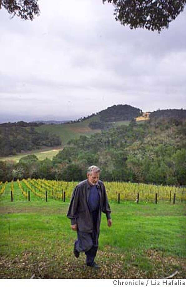 CULTWINES2-C-11DEC00-BU-LH--Top-of-the-line winemaker Bill Harlan walking the hillside above one of his vineyards. Photo by Liz Hafalia/The Chronicle Ran on: 10-06-2005  Bill Harlan, owner of Harlan Estate winery in Oakville, is renowned for his fanatic attention to detail and quality. Photo: LIZ HAFALIA