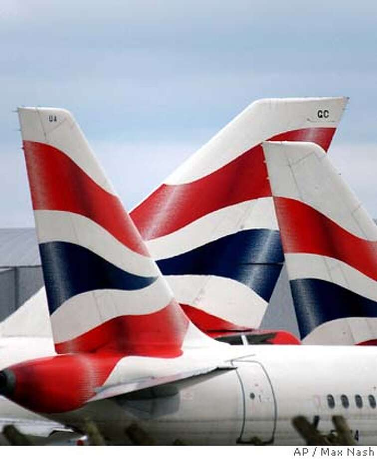 � British Airways planes are parked on the apron of terminal 4 at London's Heathrow airport, Friday Aug. 12, 2005. Thousands of passengers face long delays after BA cancelled all Heathrow flights until Friday evening, in a move prompted by an escalating industrial dispute with catering staff.(AP PHOTO/Max Nash) Photo: MAX NASH