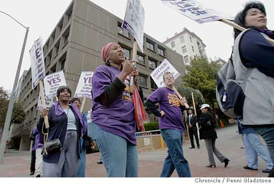 STRIKE14_0052_PG.JPG with pick scarf, Dewanda Bernard is a linen aide in house keeping at CPMC. Now she walks the picket line.  California Pacific Medical Center The union (SEIU) representing thousand of health care workers expected to go on strike today at eight Northern California hospitals decided Monday to narrow the scope of the walk out to just one hospital - California Pacific Medical Center in San Francisco. They're mad at the CEO - they say he agreed to a federal mediator's proposal but then backed down. They hope of they can get California Pacific to agree to the terms, other hospitals will follow suite. San Francisco Chronicle, Penni Gladstone  Photo taken on 9/13/05, in San Francisco, Photo: Penni Gladstone
