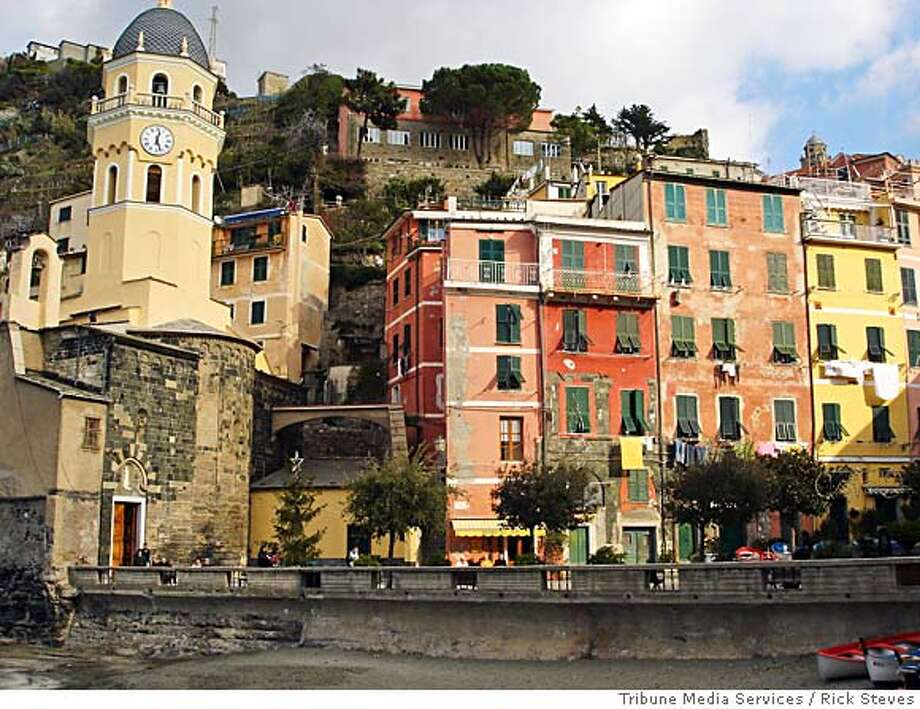 TRAVEL STEVES VERNAZZA ITALY -- The coastal town of Vernazza is magical in the morning before the crowds descend.  Rick Steves / Tribune Media Services Photo: Rick Steves