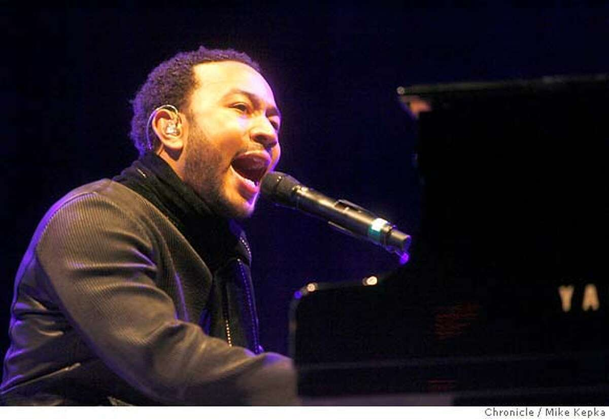 legend0900071_mk.JPG John Legend plays at the Greek Theater in Berkeley Saturday, 4/7/07. MIKE KEPKA / The Chronicle John Legend (cq) the source Ran on: 04-09-2007 John Legend, a young soul singer with chops, plays at the Greek Theatre in Berkeley.