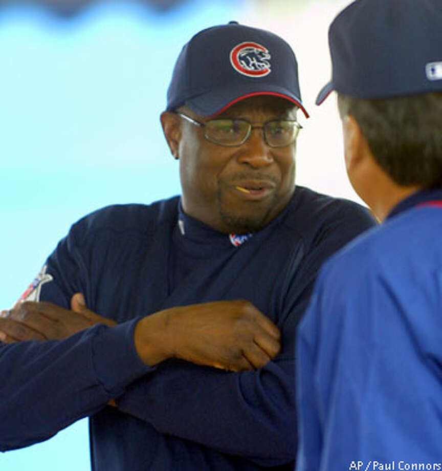Cubs manager Dusty Baker chats on the first day of spring training in Mesa, Ariz. Associated Press photo by Paul Connors