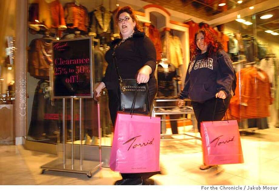 ShoppingXX_05_JMM.JPG  Amy Larson and her friend Tiffany Bank shop at the Stonestone Mall in San Francisco. Larson no longer treks to the Pennisula to shop and instead stays local.  Event on 9/27/05 in San Francisco. JAKUB MOSUR / The Chronicle MANDATORY CREDIT FOR PHOTOG AND SF CHRONICLE/ -MAGS OUT Photo: JAKUB MOSUR