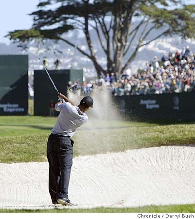 Tiger Woods hits an approach shot from the fairway bunker on the 18th hole at the American Express Championship at Harding Park Golf Course.  Event on 10/6/05 in San Francisco.  Darryl Bush / The Chronicle Photo: Darryl Bush
