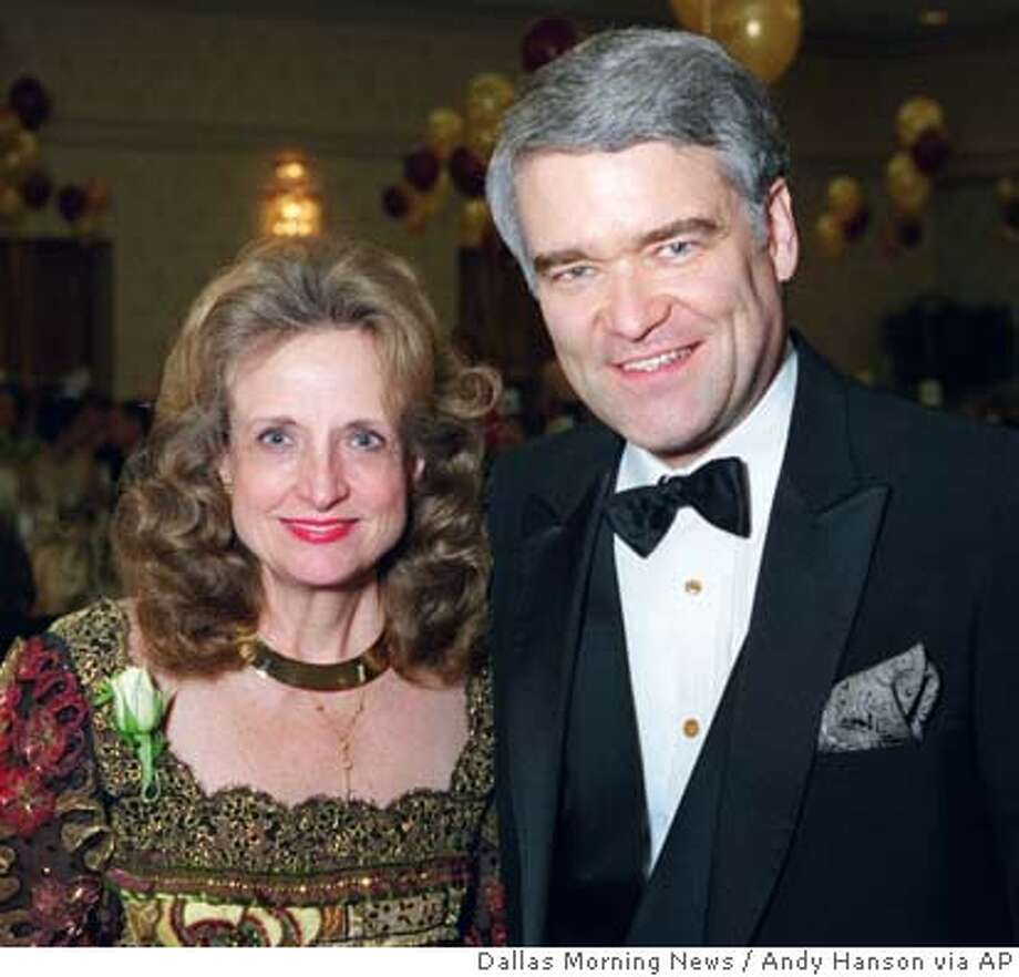 Harriet Miers and Nathan Hecht are shown in this photograph taken as they attended the Dallas Bar Association Gala in Dallas, Texas, Jan. 19, 1998. Supreme Court nominee Harriet Miers' footprints on contentious social issues suggest a moderate position on gay rights, an interest in advancing women and minorities and sympathy for anti-abortion efforts. Judging from the Smith & Wesson she once packed, she favors gun rights, too. Miers once owned a .45-caliber revolver, a gift from a brother who was worried about her safety when she lived alone in Dallas, says Judge Nathan Hecht of the Texas Supreme Court, who has known Miers for 30 years and has dated her. (AP Photo/the Dallas Morning News, Andy Hanson) ** , NO MAGS, NO TV, NO INTERNET: AP MEMBERS ONLY ** , NO MAGS, NO TV, NO INTERNET: AP MEMBERS ONLY Photo: ANDY HANSON