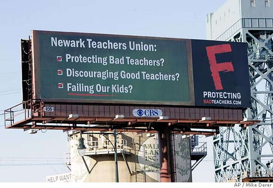 A billboard sponsored by the Center for Union Facts, a Washington, D.C.-based advocacy group is seen along a major roadway in Newark, N.J., Thursday, March 29, 2007. A previous billboard paid for by the Newark Teachers Union on the thoroughfare in Newark asked for help in stopping killings in the state's largest city. (AP Photo/Mike Derer) Photo: Mike Derer