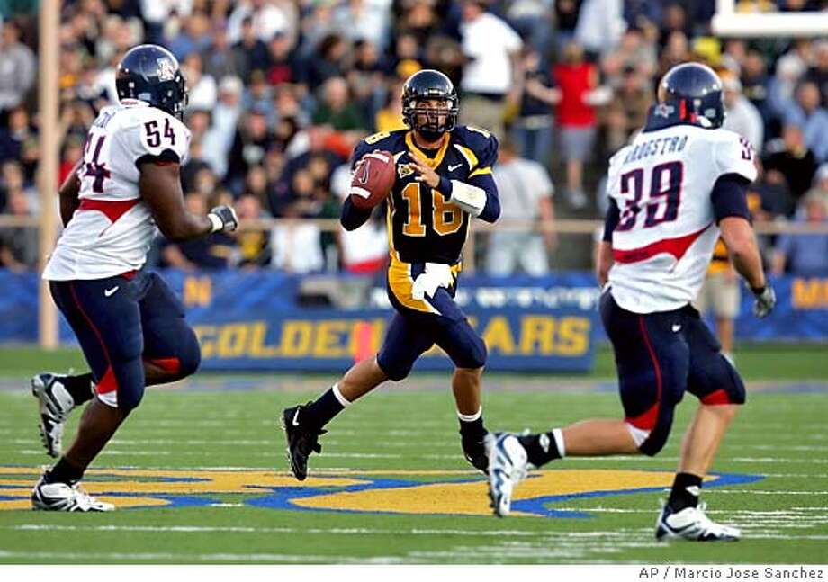 California quarterback Joe Ayoob, center, looks to pass as Arizona's Lionel Dotson, left, and Dane Krogstad (39) pursue in the second half on Saturday, Oct.. 1, 2005, in Berkeley, Calif. (AP Photo/Marcio Jose Sanchez) Photo: MARCIO JOSE SANCHEZ