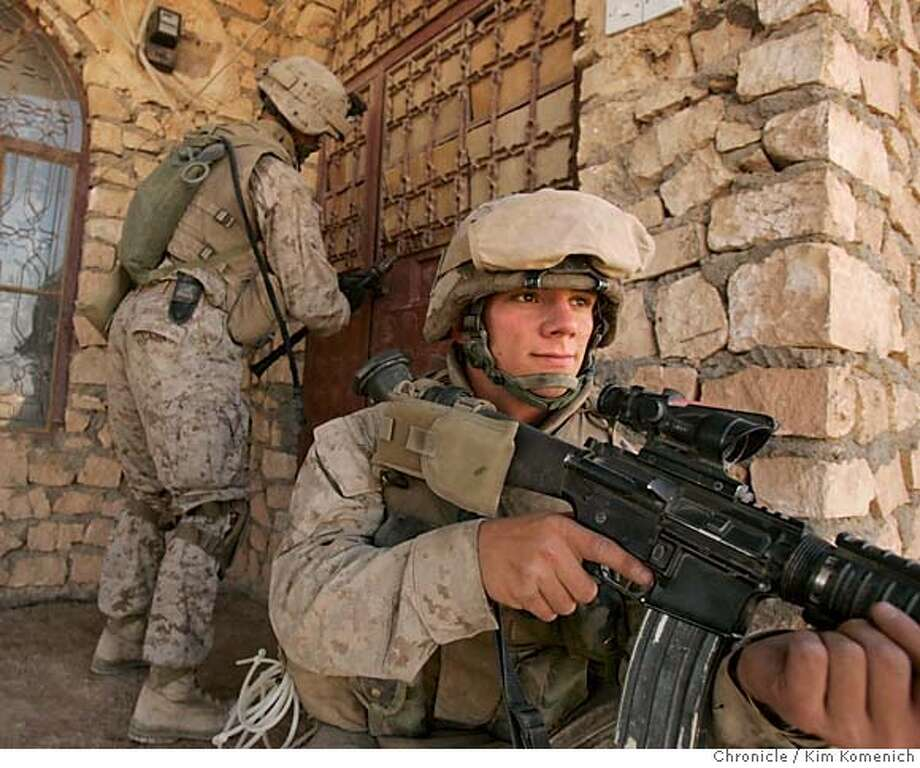"IRAQ05_MOSQUE_0002_KK.JPG  (EDS: This image was edited from photos taken on Oct 1 to go with IRAQ05_MOSQUE. --kk)  Marines from Kilo Company, 3rd Battalion, 6th Marines Regiment, attached to the 2nd Regimental Combat Team begin ""Operation Iron Fist"" by performing house-to-house searches in the town of Karabila on the Iraq-Syrian Border. San Francisco Chronicle Photo by Kim Komenich  10/1/05 Photo: Kim Komenich"