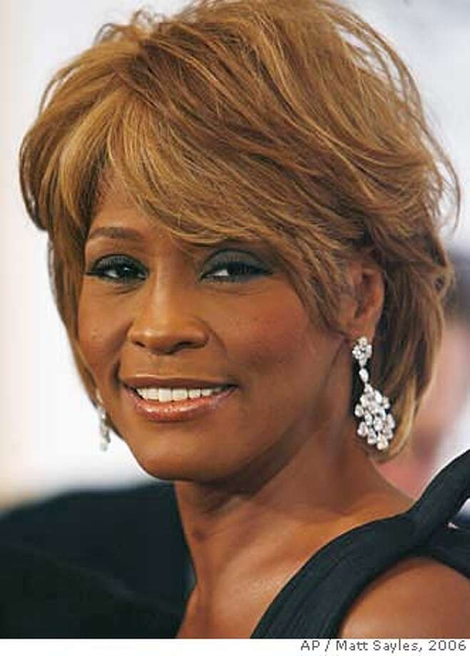 **FILE** Musician Whitney Houston arrives at the 17th Carousel of Hope Ball benefiting the Barbara Davis Center for Childhood Diabetes in Beverly Hills, Calif., Oct. 28, 2006. Houston's divorce from singer Bobby Brown will become final on April 24 and Houston will have custody of the couple's 14-year-old daughter, a judge ruled Wednesday April 4, 2007. (AP Photo/Matt Sayles-File) OCT 28 2006 FILE Photo: MATT SAYLES