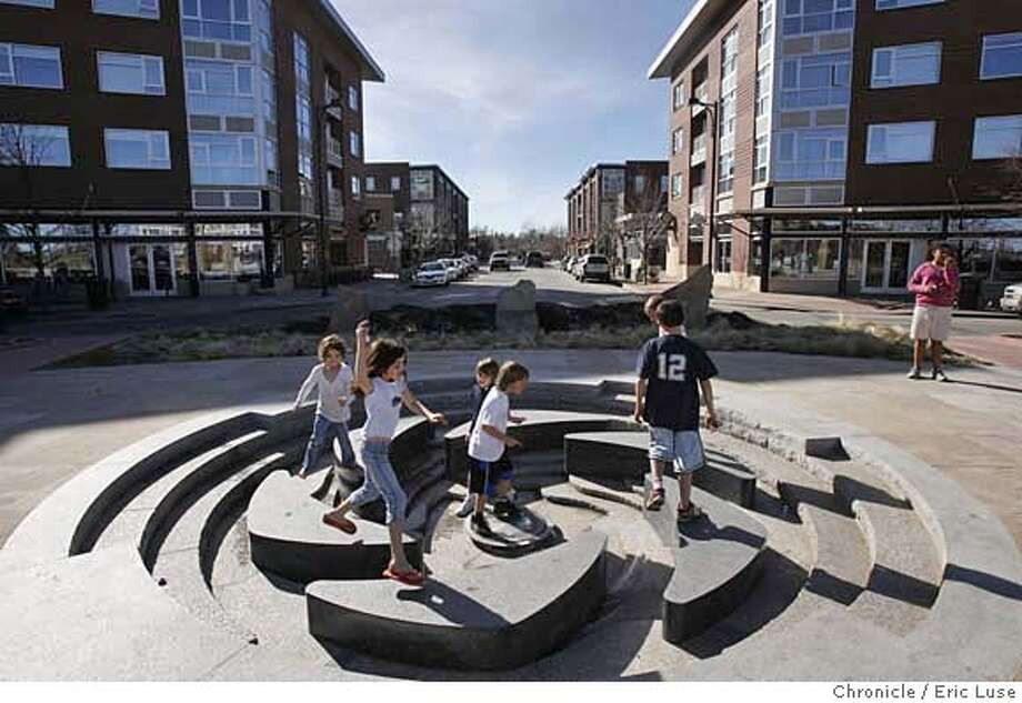 urbandesign_stapleton_0449_el.JPG  The Founder's Green is meant to be a gathering place. Kids turn these water fountains (turned off for winter) into a creative playground with the small town center behind them.  Stapleton community at the old site of the Denver airport is a diverse mix of home styles.  Photographer:  Eric Luse / The Chronicle names cq from source MANDATORY CREDIT FOR PHOTOG AND SF CHRONICLE/NO SALES-MAGS OUT Photo: Eric Luse
