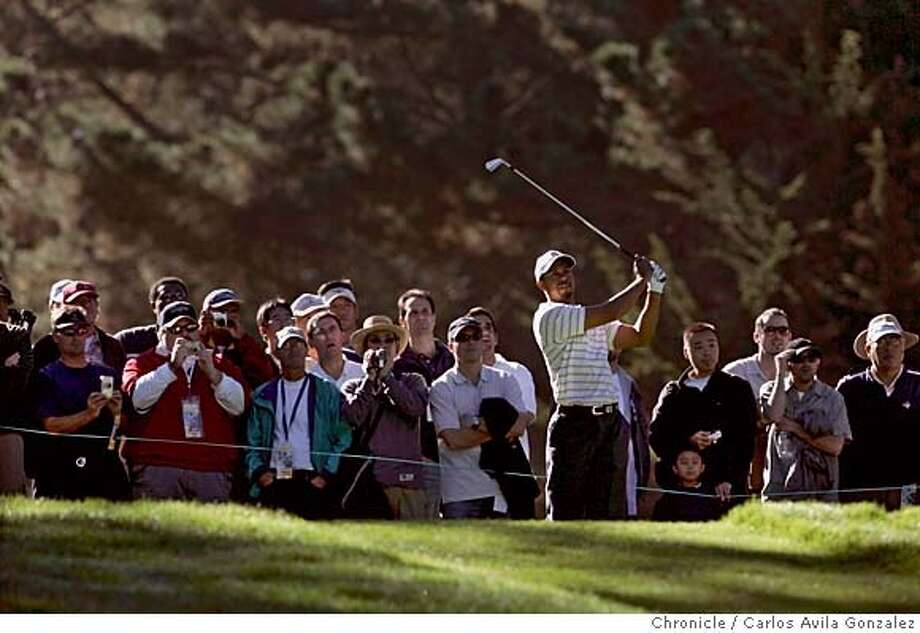AMEXGOLF_001_CG.JPG  Tiger Woods hits his tee shot on the sixteenth hole at Harding Park Golf Course on Tuesday, October 4, 2005. First day of practice on Tuesday, October 4, 2005, for the American Express Championship at Harding Park Golf Course in San Francisco, Ca. Photo by Carlos Avila Gonzalez / The San Francisco Chronicle  Photo taken on 10/4/05, in San Francisco,CA. Photo: Carlos Avila Gonzalez
