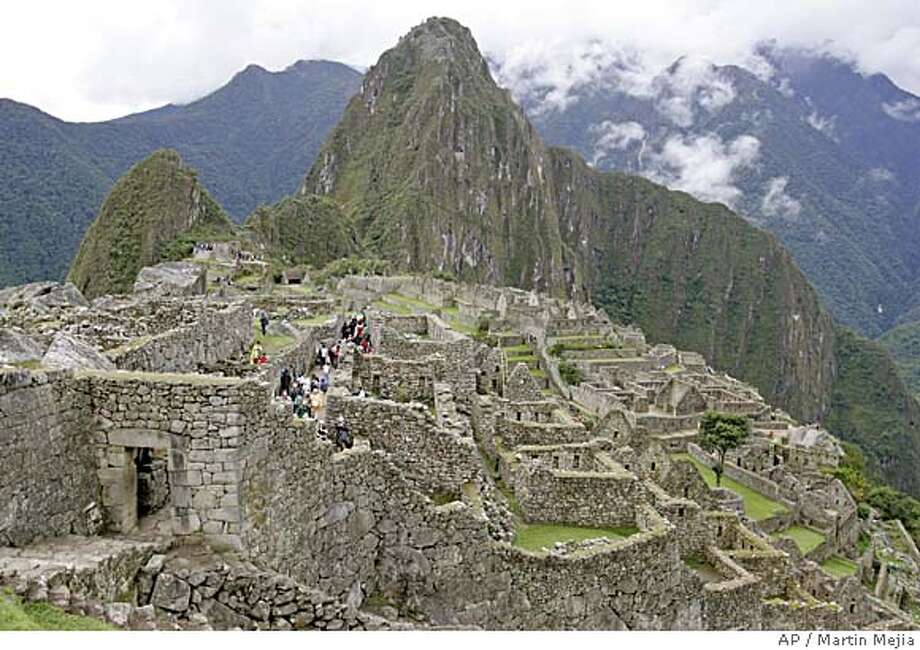 ** FILE ** View of Peru's famed Machu Picchu ruins in this July, 2006, file photo. A new bridge was inaugurated Saturday in the village of Santa Teresa, over the turbulent Vilcanota River, despite the objections of government cultural experts, who fear increased tourism could threaten the UNESCO World Heritage site as hostels and restaurants spring up to serve travelers. (AP Photo/Martin Mejia) Photo: Martin Mejia