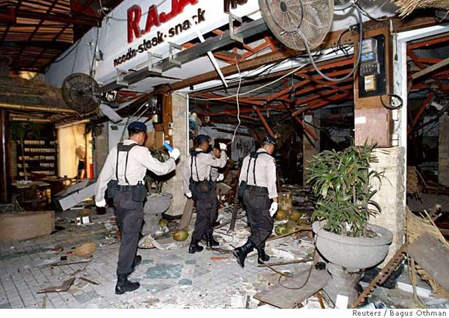 Indonesian security officials inspect the scene of an explosion at a restaurant in Kuta, after bomb blasts ripped through popular tourist areas on the Indonesian resort island of Bali October 1, 2005. At least 21 people died and 85 were wounded in bomb blasts in Kuta Square shopping centre and Jimbaran Beach on Bali island on Saturday, officials said. Indonesia's President Susilo Bambang Yudhoyono condemned as terrorism the nearly simultaneous blasts, which come three years after militants linked to al Qaeda bombed two nightclubs in Bali, killing 202 people, mainly foreign tourists. REUTERS/Bagus Othman 0 Photo: STRINGER/INDONESIA