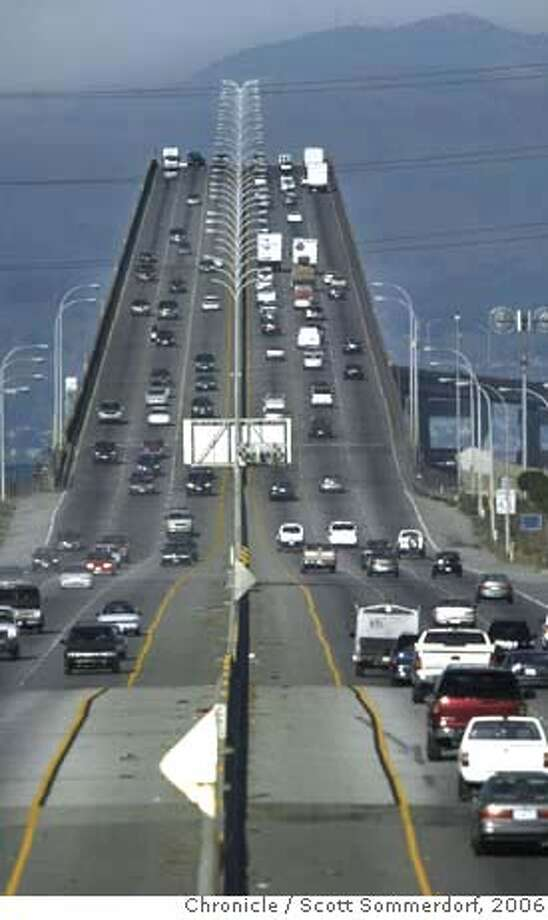 BRIDGE1-c-04NOV02-MT-SS --- Looking east along Highway 92, the San Mateo Bridge shows smooth flowign traffic with the new lanes in use. SF CHRONICLE PHOTO BY SCOTT SOMMERDORFRan on: 04-14-2006 Ran on: 05-10-2006 Ran on: 07-08-2006 Ran on: 07-08-2006 CAT Photo: SS
