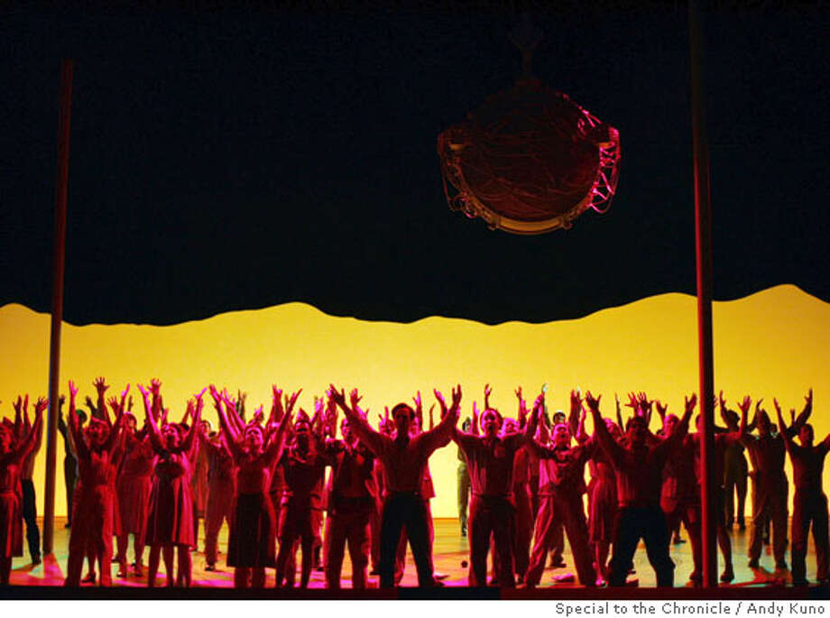 "Cast members perform underneath the atomic bomb during the ""Doctor Atomic"" rehearsal at the War Memorial Opera House in San Francisco Wednesday September 28, 2005. Photo by ANDY KUNO/Special to the Chronicle Photo: ANDY KUNO"