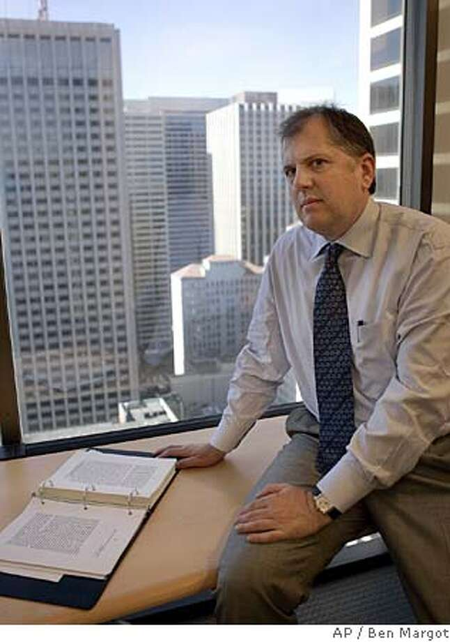 """Attorney H. Joseph Escher III is seen in the offices of Dechert LLP Monday, Oct. 3, 2005, in San Francisco. R.J. Reynolds Tobacco Co. doled out free packs of cigarettes, and in some cases, free cartons to nearly 15,000 adults at six California public events ranging from a San Jose beer festival to a motorcycle event in Del Mar. Six years later, after losing two court challenges, the cigarette maker is still challenging the $14.8 million fine for violating a 1991 state law prohibiting freebies. The penalty, now about $18 million and growing with interest, is one of the state's largest levied against a company. For its part, R.J. Reynolds says, just open a dictionary to the word """"promotion,"""" and the company's right to free giveaways is clear. H. Joseph Escher III, an attorney representing the company before the state high court, said, """"To be frank, a free sample is a promotion. That is the way it is used in normal speech and the way people understand it."""" (AP Photo/Ben Margot) Photo: BEN MARGOT"""