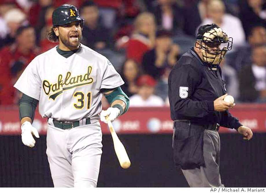 Oakland Athletics designated hitter Mike Piazza reacts after a called third strike in the sixth inning against the Los Angeles Angels in a baseball game Saturday, April 7, 2007, in Anaheim, Calif. (AP Photo/Michael A. Mariant) Photo: Michael A. Mariant