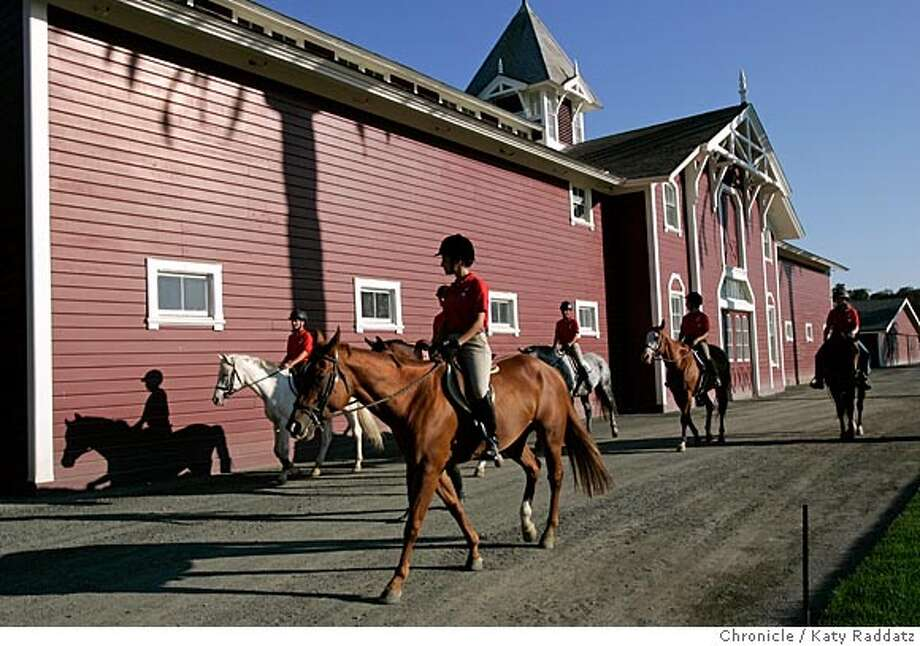 The historic Red Barn on the Stanford University campus. It has been recently renovated, along with the surrounding grounds, arenas, and outbuildings. SHOWN: students in an afternoon class taught by Vanessa Bartsch walk their horses past the Red Barn to an arena. Vanessa Bartsch (who is NOT shown here) is the manager of the Red Barn. Photo taken on 9/21/05, in Palo Alto, CA.  By Katy Raddatz / The San Francisco Chronicle Photo: Katy Raddatz