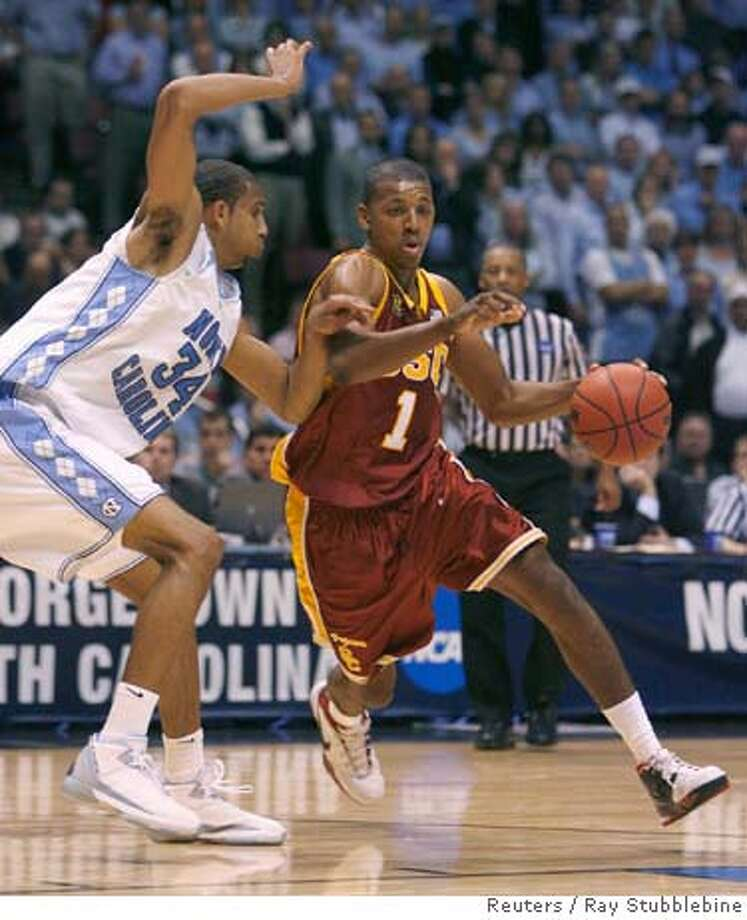 USC Trojans Nick Young (R) drives past University of North Carolina Tar Heels Brandan Wright (L) during the second half of their NCAA men's East Regional semi-final basketball game in East Rutherford, New Jersey, March 23, 2007. REUTERS/Ray Stubblebine (UNITED STATES) 0 Photo: RAY STUBBLEBINE
